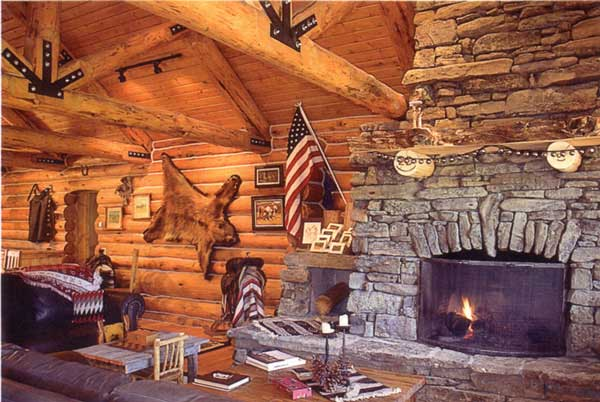 The interior of the lodge features a beautiful rock fireplace